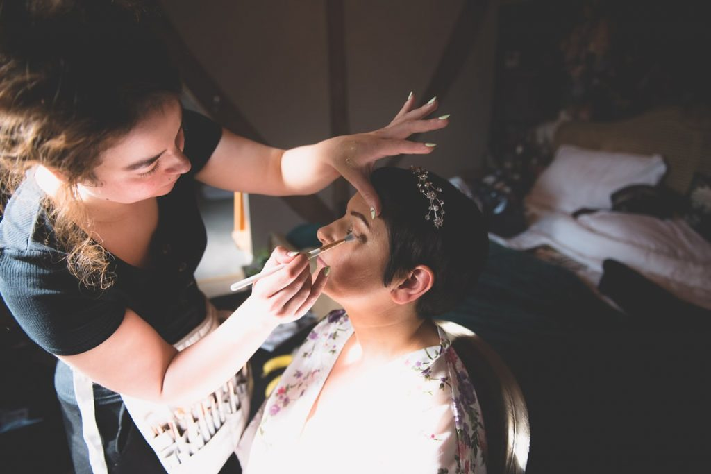 The makeup artist applying eye shadow