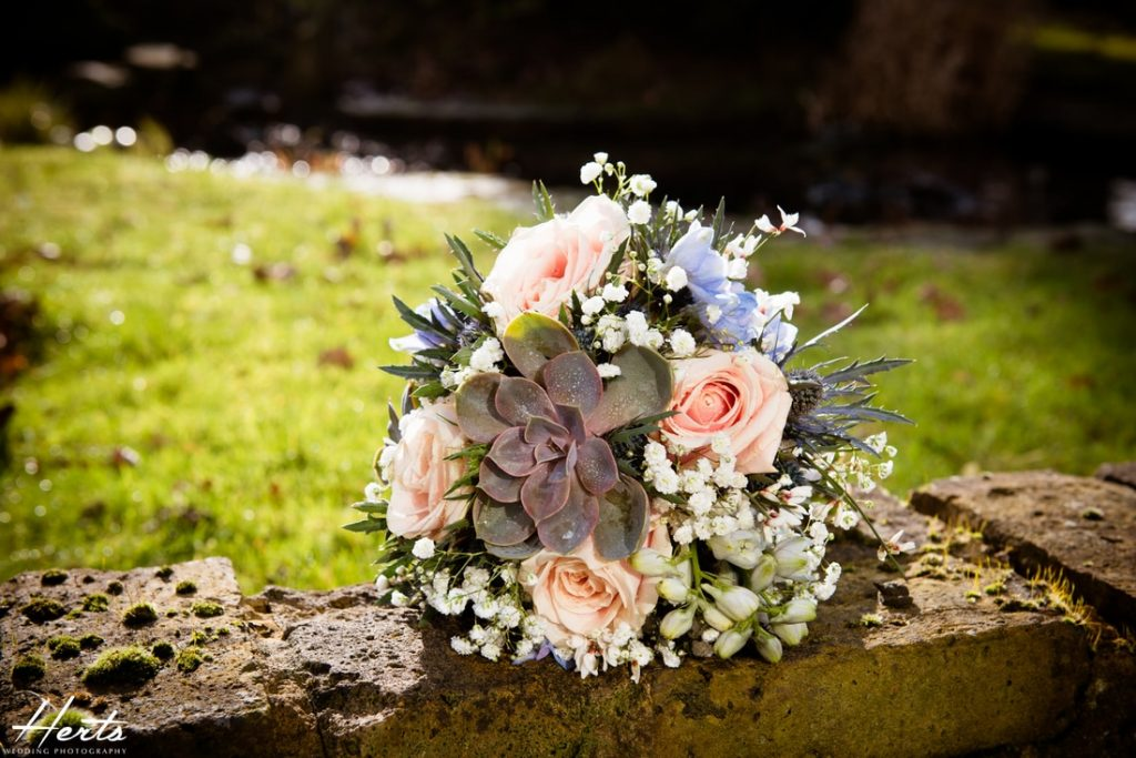 The bridal bouquet on a wall