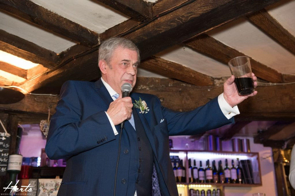 The father of the bride proposes a toast to the bride and groom