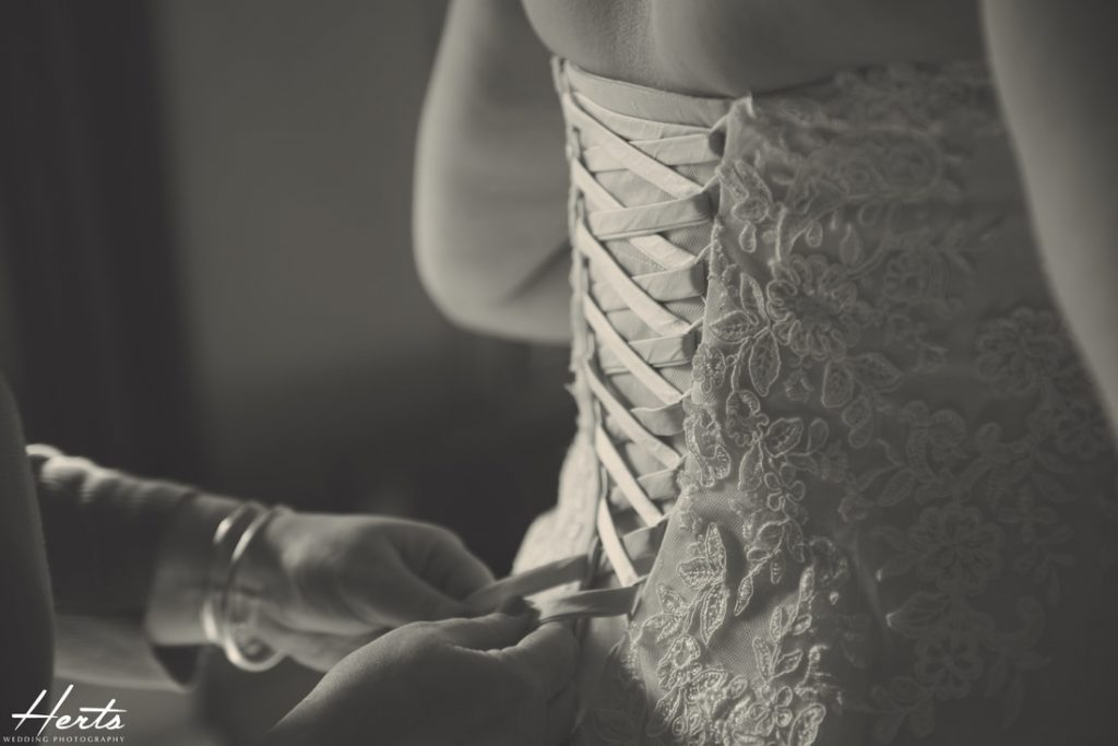 The wedding dress is laced up at the back