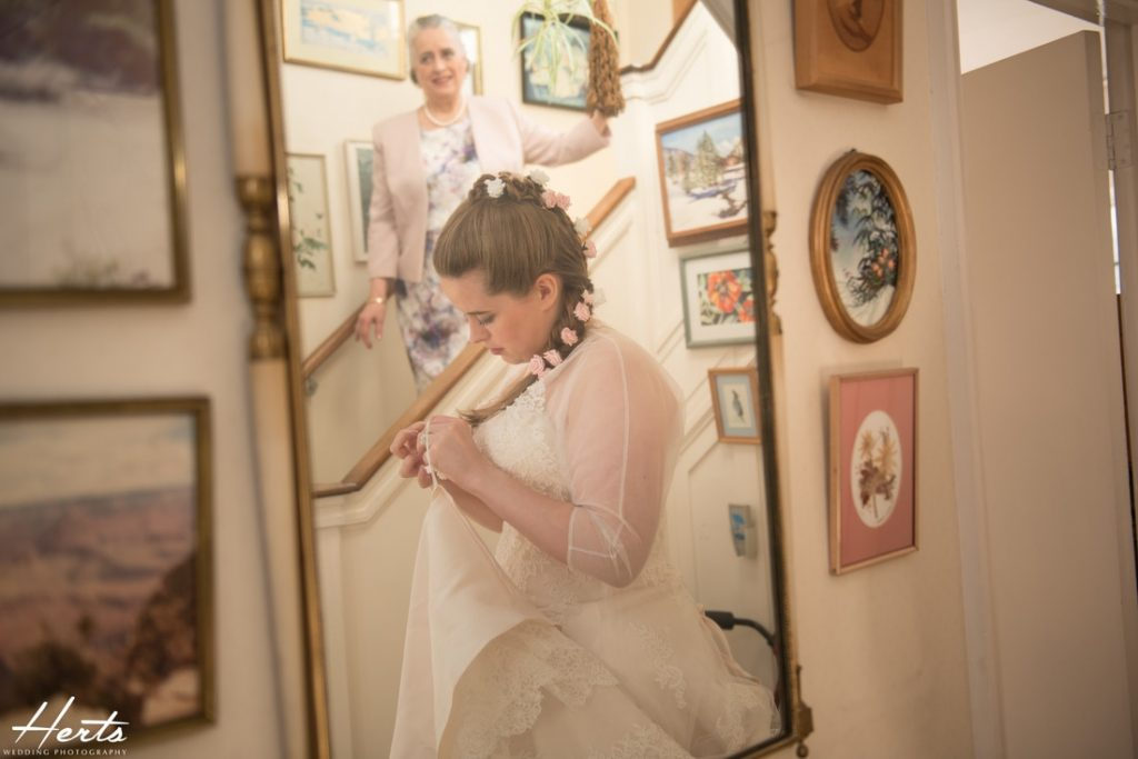 A photo taken of the bride in a mirror