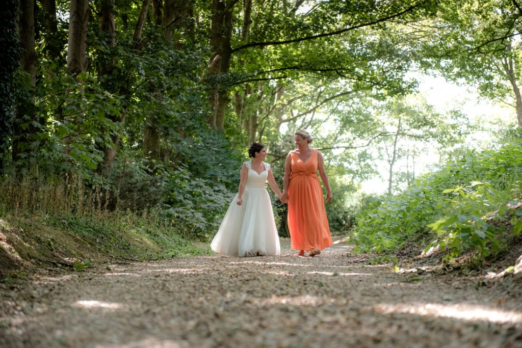 The two brides walk hand in hand