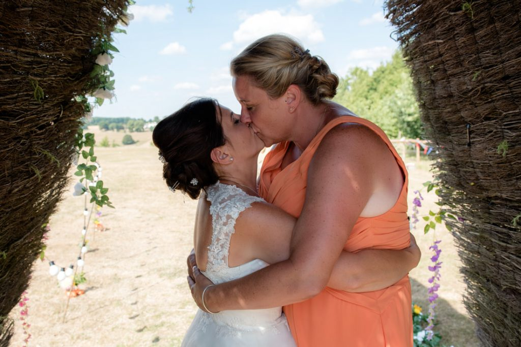 The two brides kiss