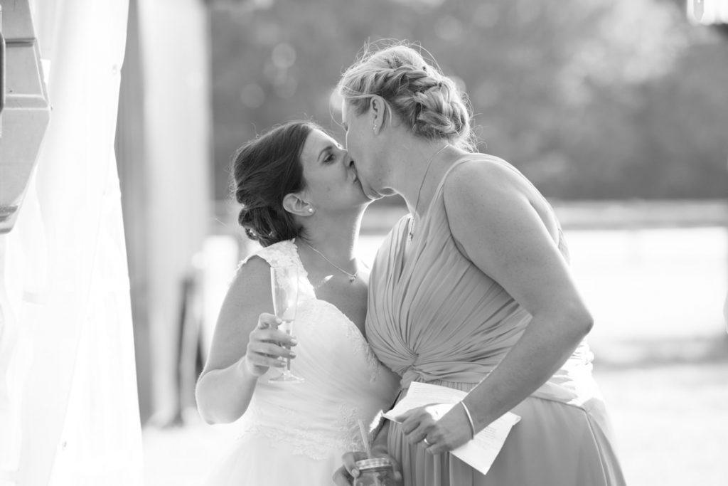 The same sex couple kiss