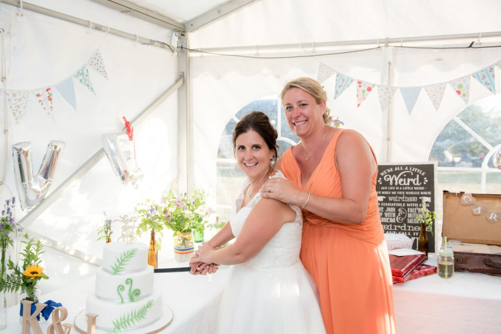 The two brides cut the cake