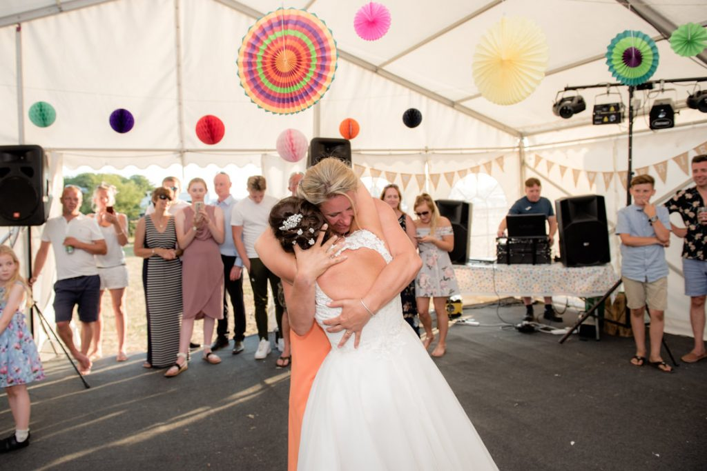 The two brides dance together