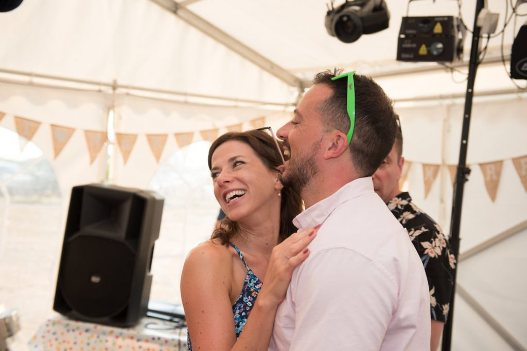 Guests dance together at this same sex wedding