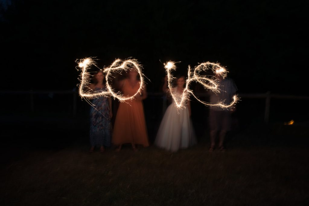 The word love written with sparklers