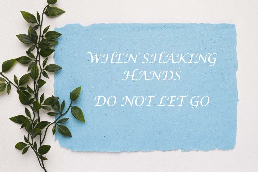 Wedding task game to not let go when shaking hands