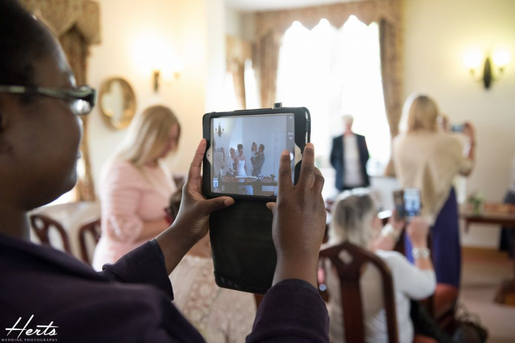 Guests take photos on their phones and tablets