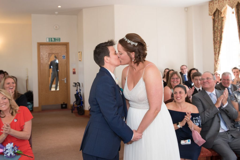 The 2 brides share their first kiss as wife and wife