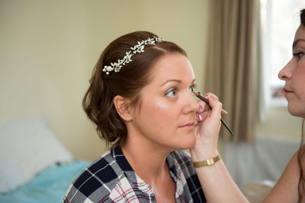 Bride having eyeliner applied