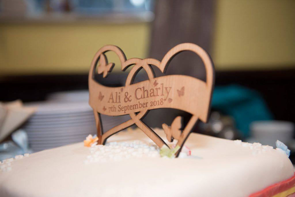 A wooden Wedding cake topper