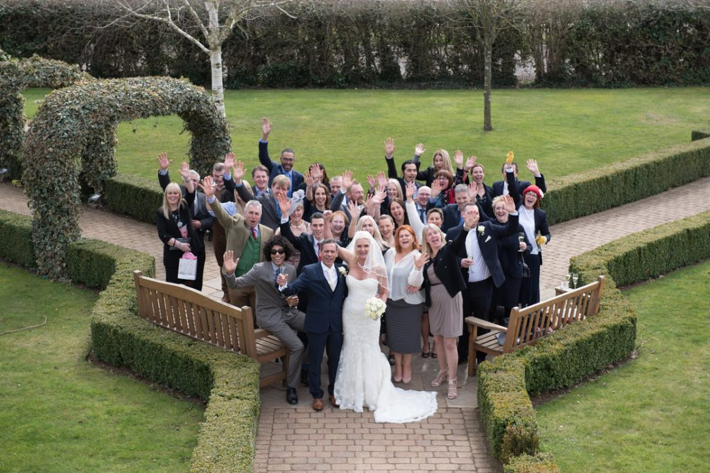 Standing on the roof of Tewin Bury Farm for a wedding photo