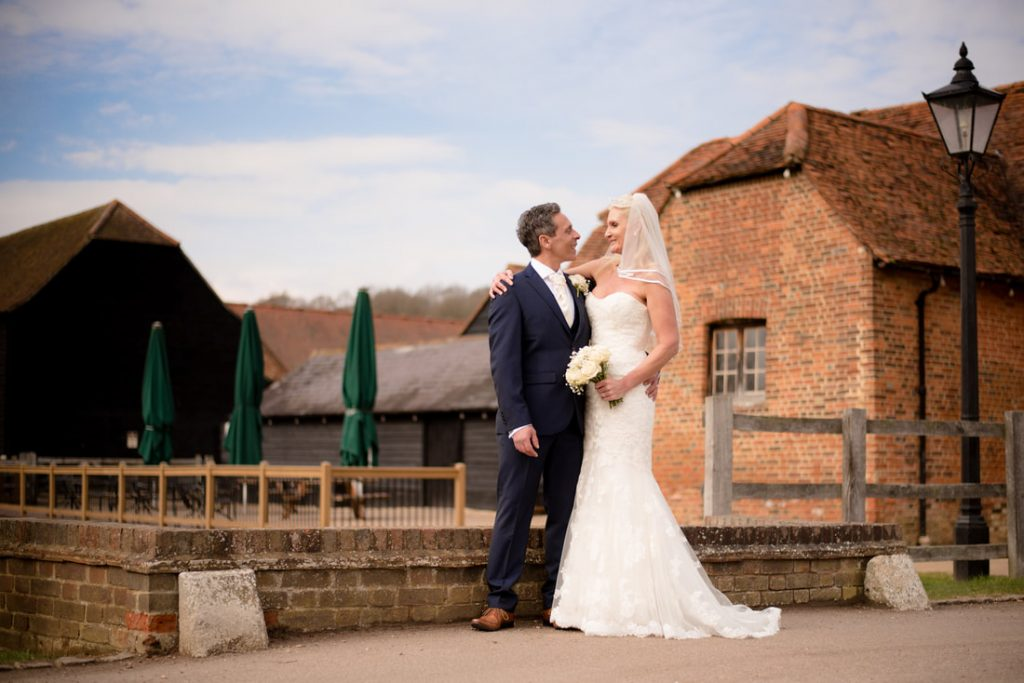 A wedding portrait of the bride and groom at Tewin Bury Farm