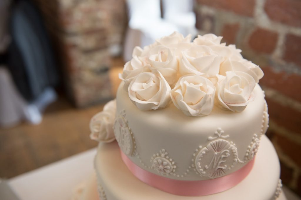 Iced flowers on the top of the wedding cake