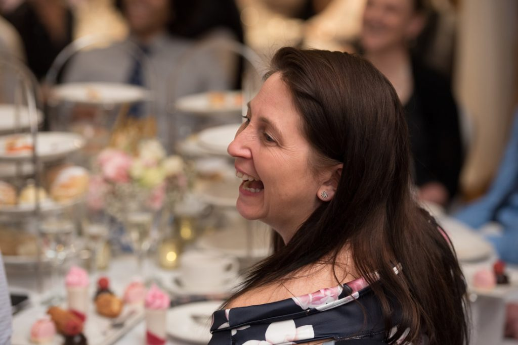 A guest laughing at the wedding speeches