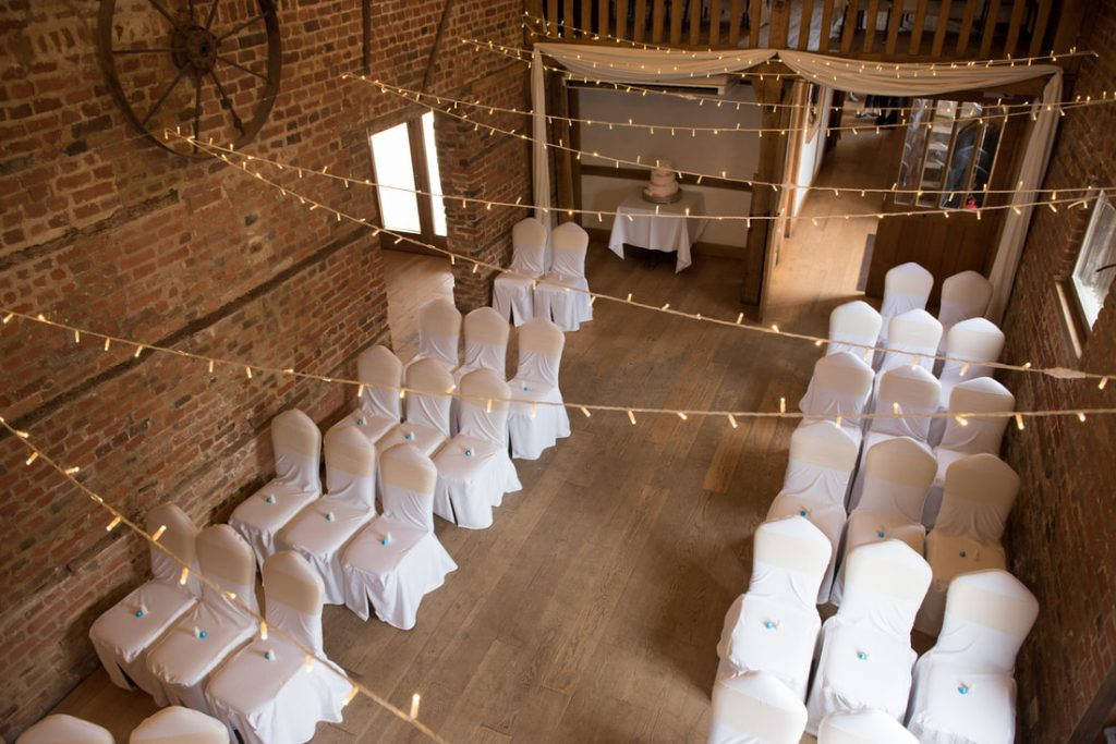 A photo looking down in the Stables where the wedding ceremony will take place