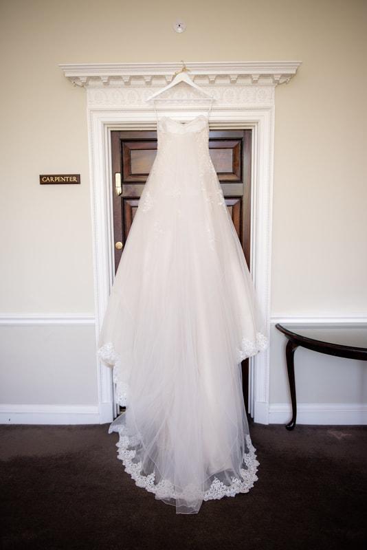 Wedding dress hanging from door drame