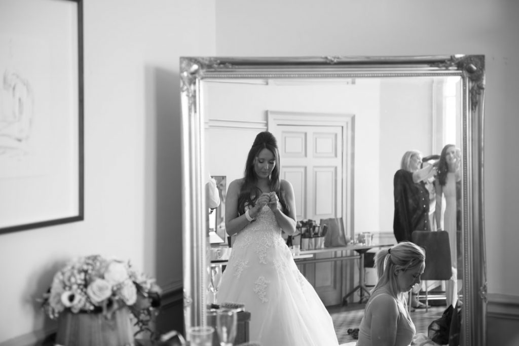 The bride reflected in a large mirror