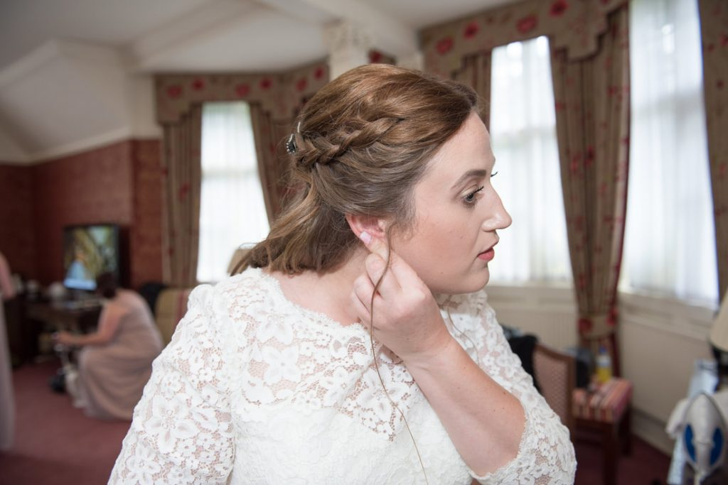 The bride putting in her earrings