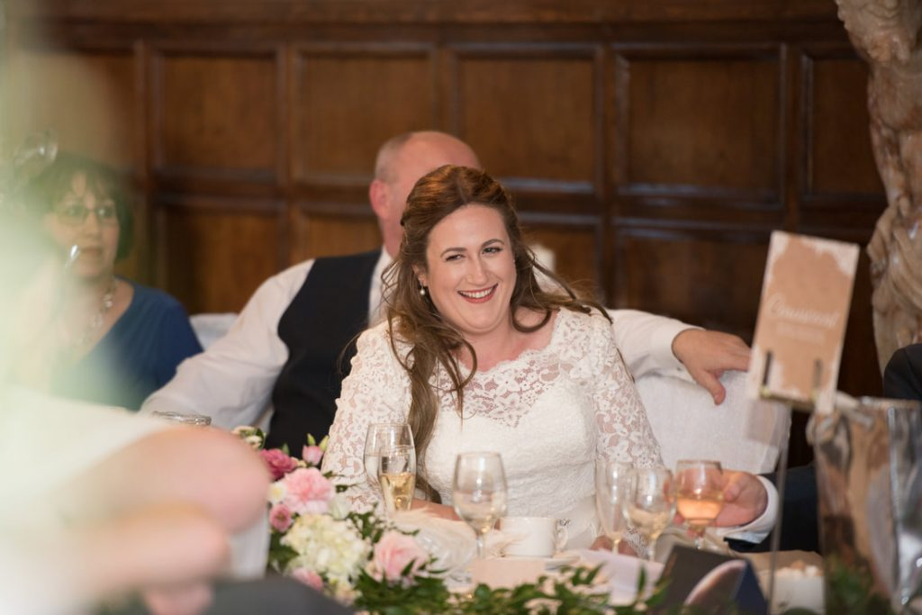 The bride laughing at a joke