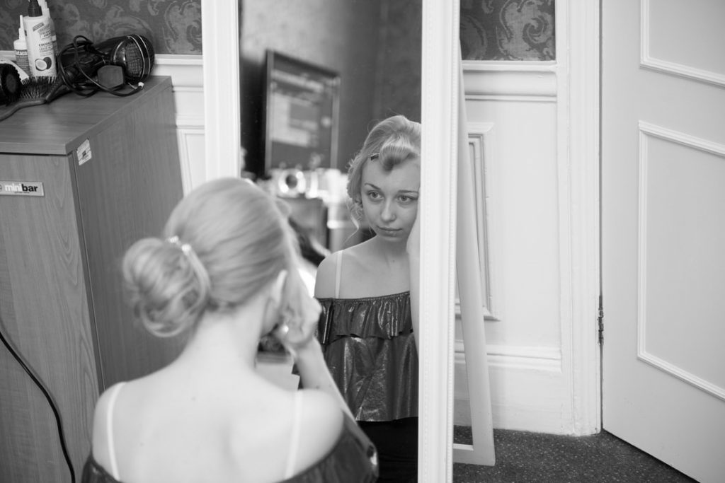 Bridesmaid applying makeup