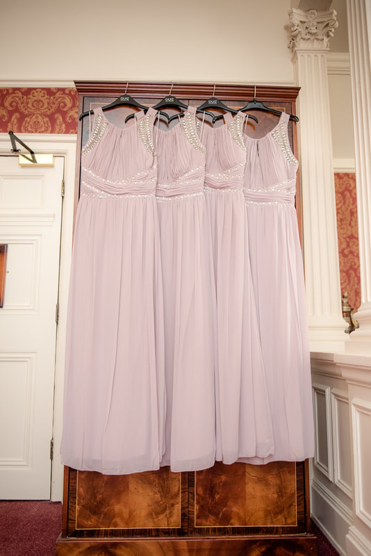 Bridesmaid dresses hanging on a wardrobe