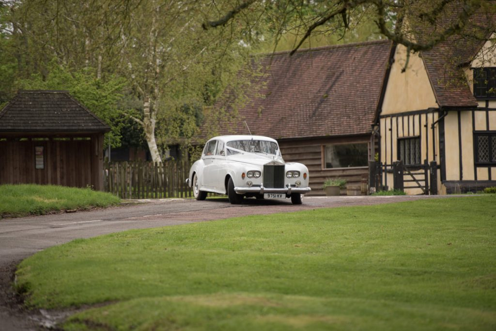 The wedding car arrives at the church