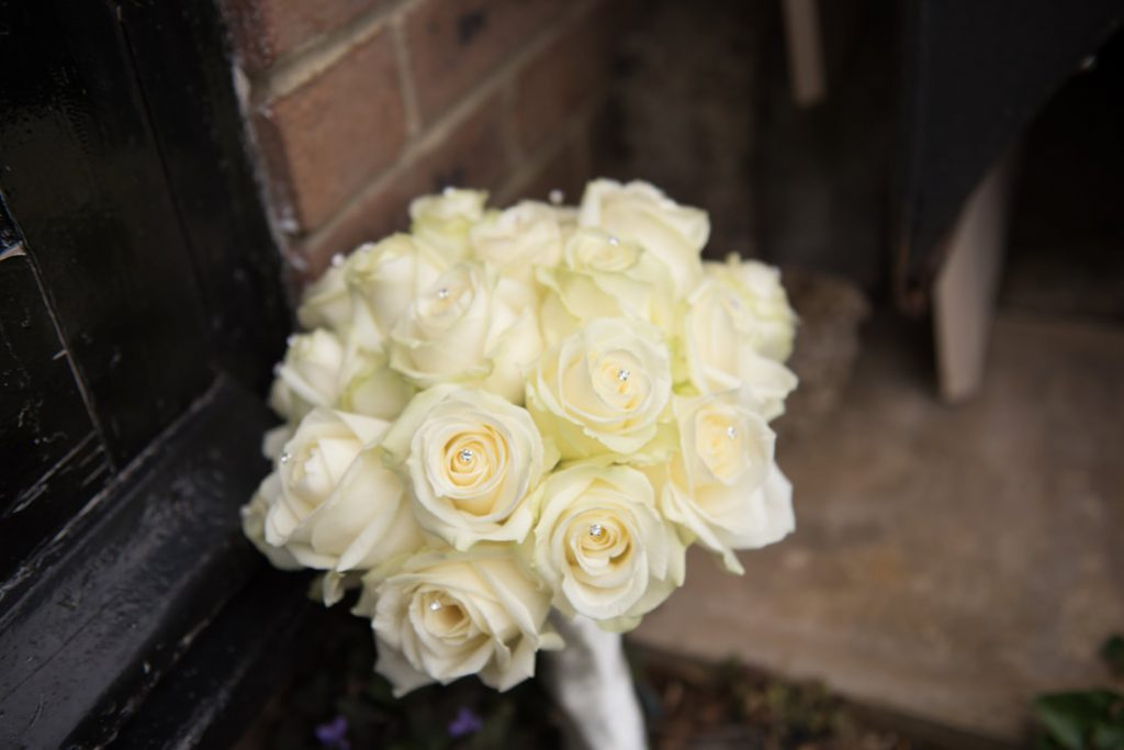 The bridal bouquet of flowers place outside the front door