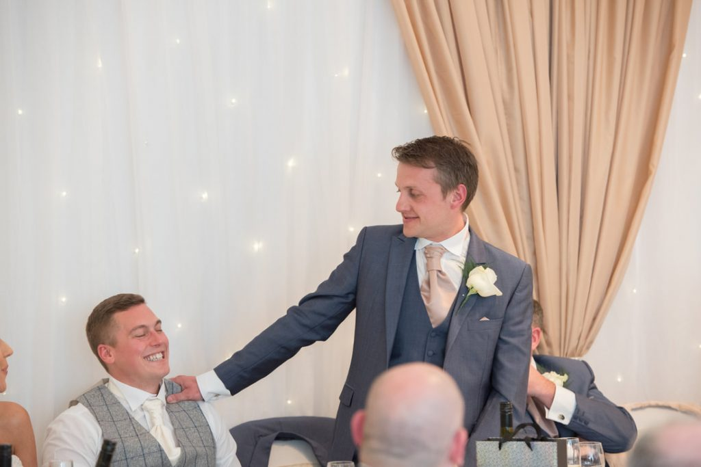 The best man telling stories about the groom