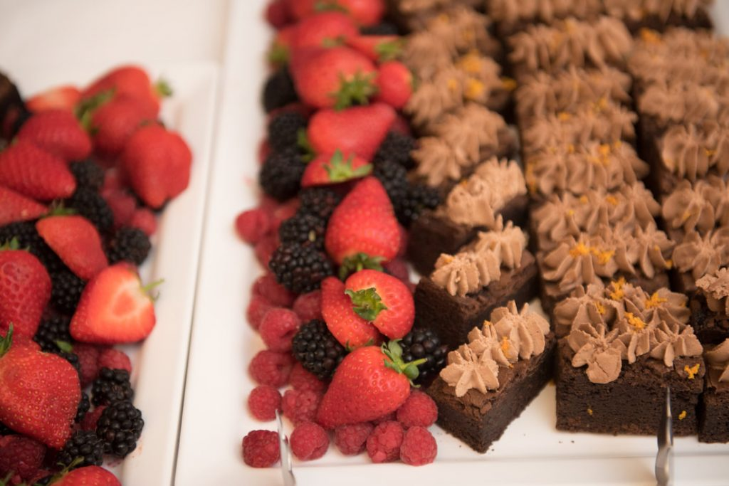 A selections of strawberries and cakes available for dessert