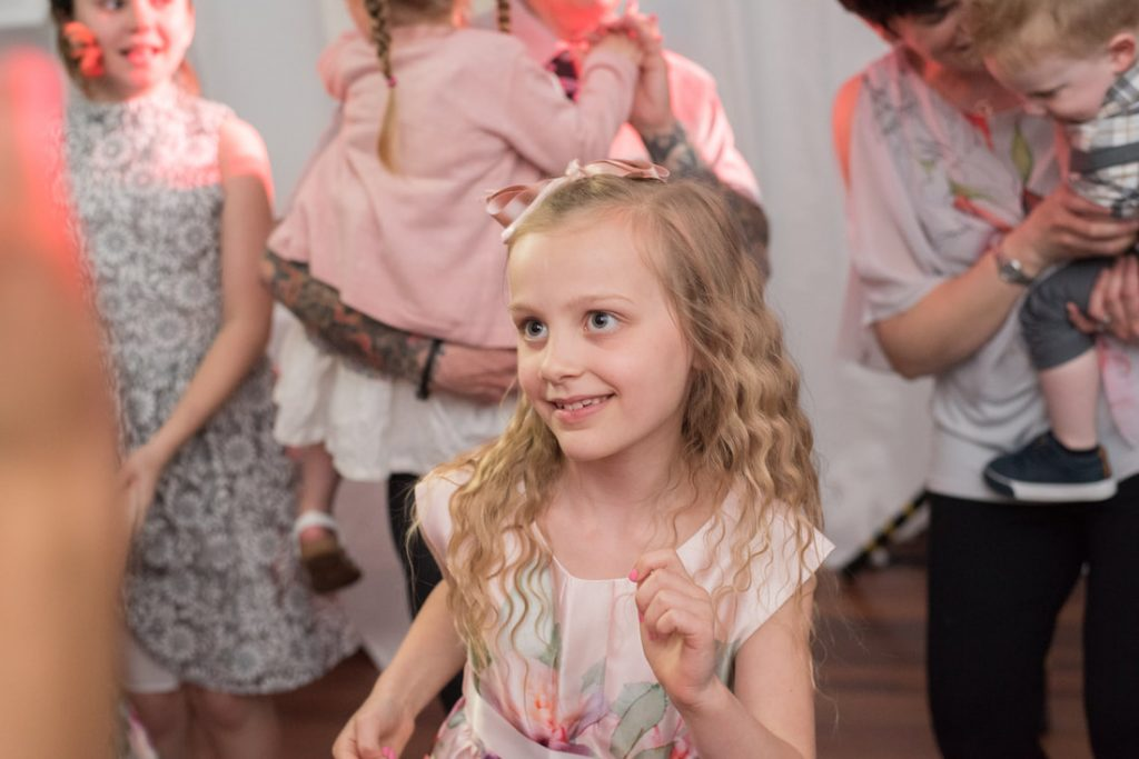 A young lady dancing at the wedding held at Ware Priory
