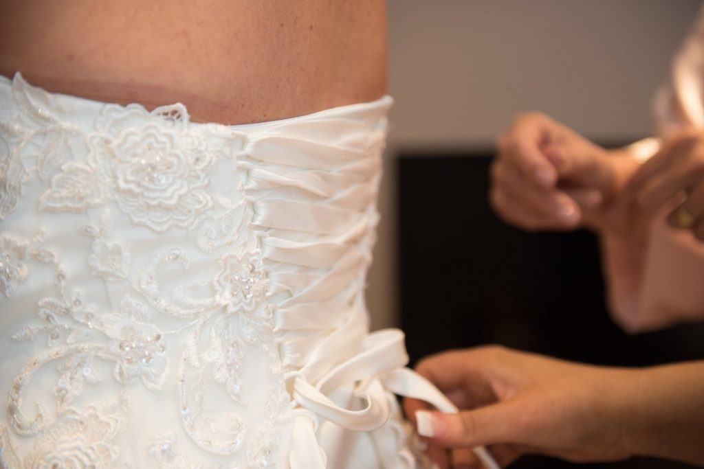 The lace flower decorations on the back of the wedding dress