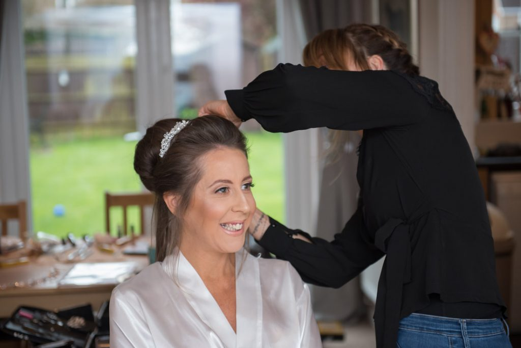 Hair and makeup preparations with the bride