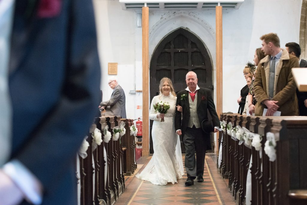 bride walking up the church aisle