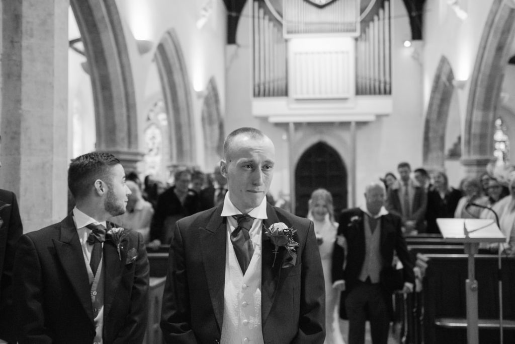 The emotional groom awaiting the bride