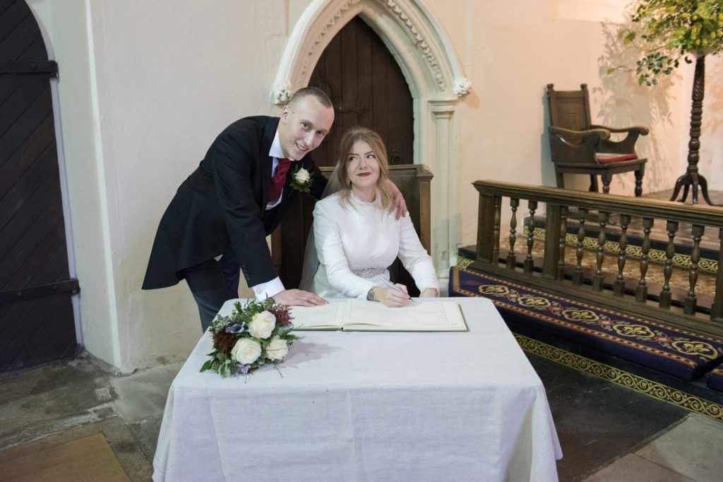 Signing of the wedding register in hertfordshire church