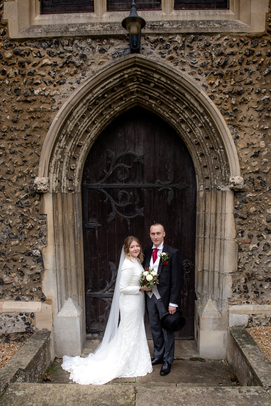 Wedding portrait outside wheathampstead church