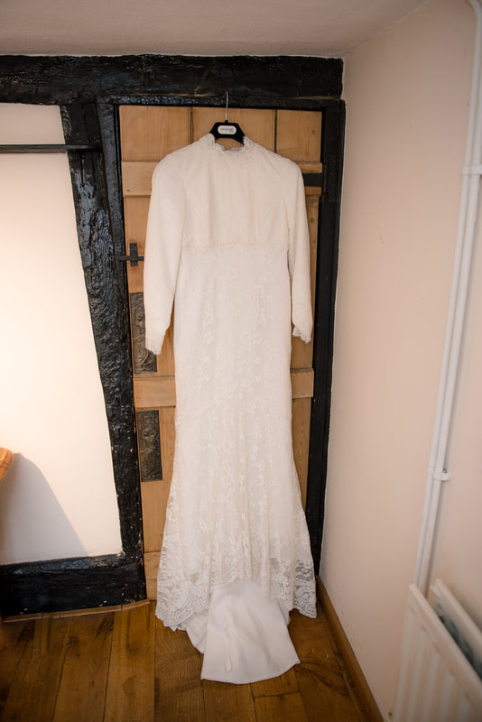 Wedding dress hanging on kitchen door