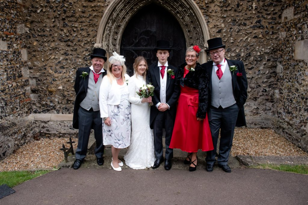 Group wedding photo taken at St Helens Church