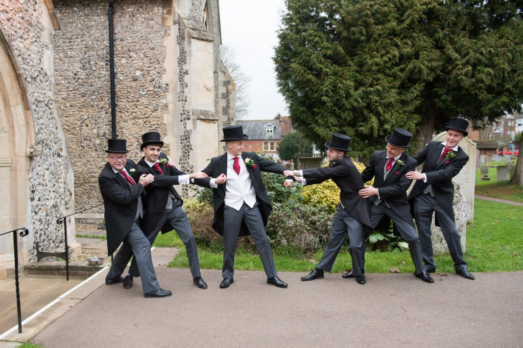 The groom having fun with his groomsmen