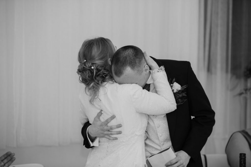 Bride and groom sharing an emotional moment