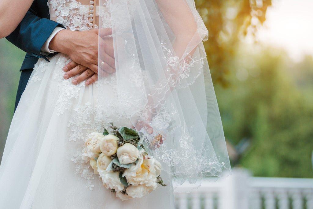 Wedding dress & bouquet of flowers