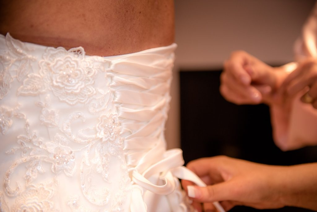 The lacing of the wedding dress