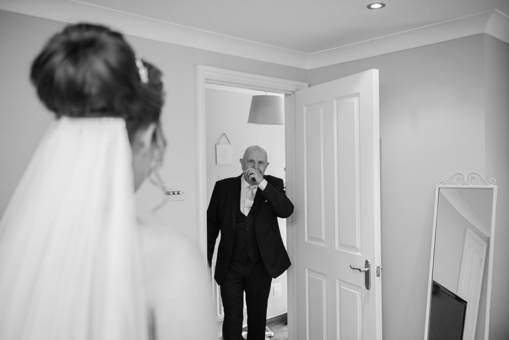 The first look of the bride from her dad