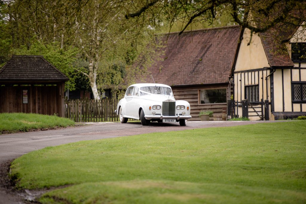 The arrival of the wedding car at the church