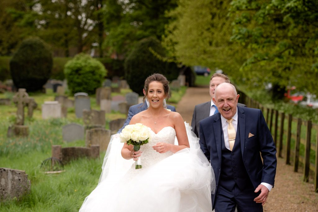 The bride and her dad outside of the church
