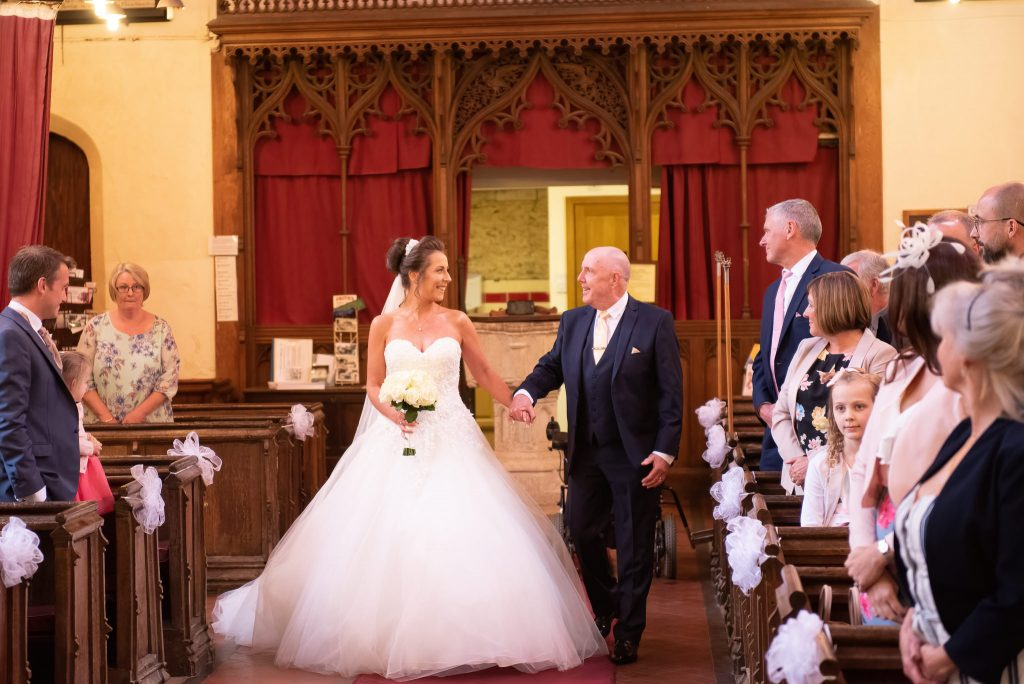 The brides dad walks her up the aisle