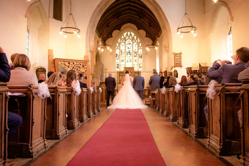 The bridal party at the front of the church